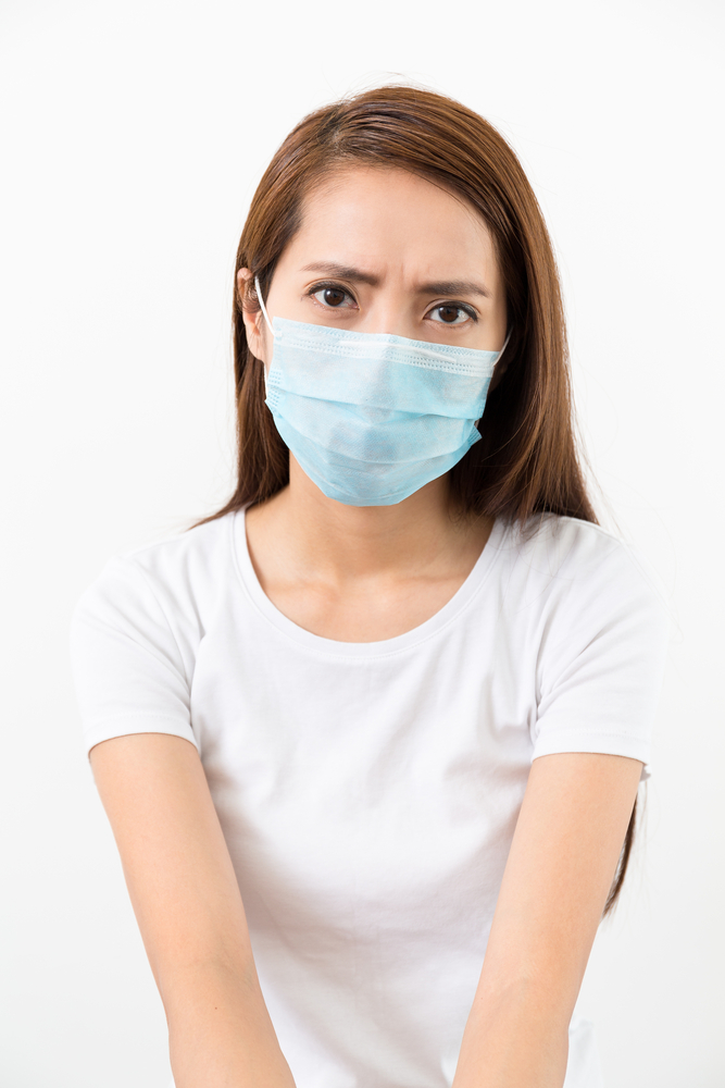Concerned physician wearing mask
